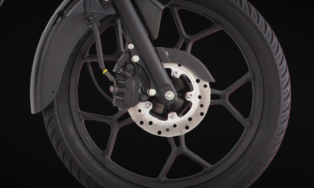 front wheel of bajaj discover 125cc disc motorcycle with spider mag wheels and disk break system
