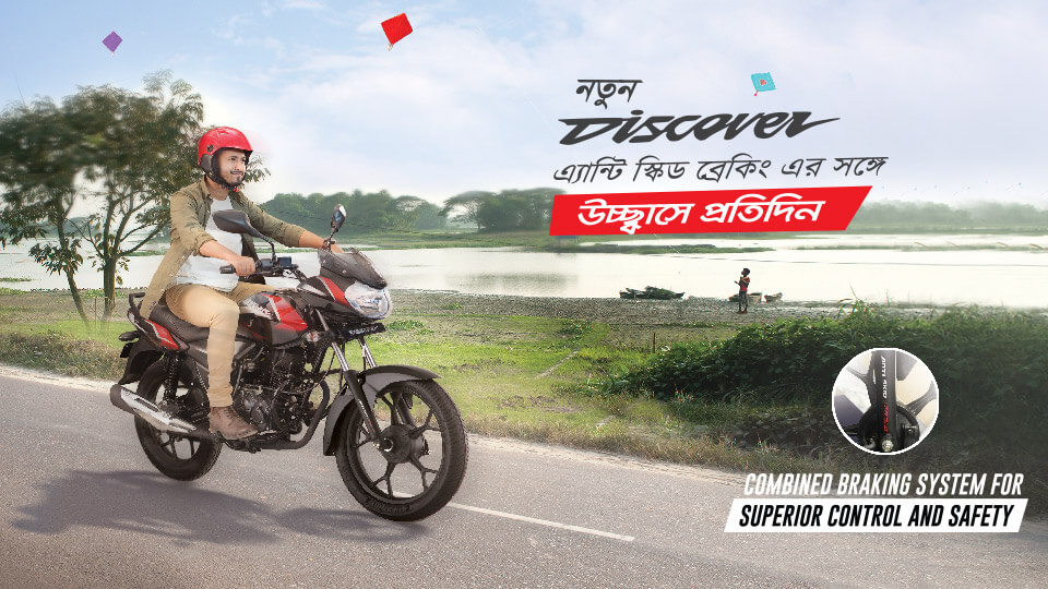 A man riding black and red color Bajaj discover 125cc drum motorcycle on the road with red helmet