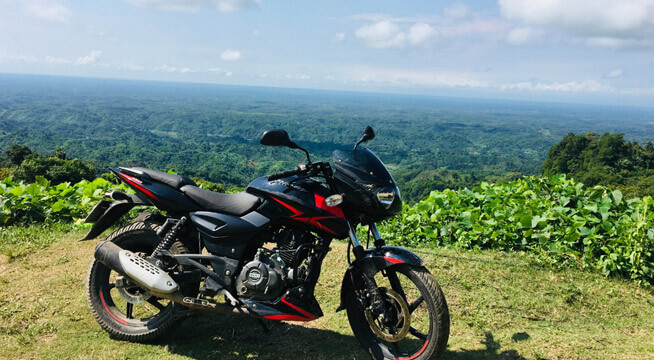 Red Pulsar 150 Twin Disc on hill