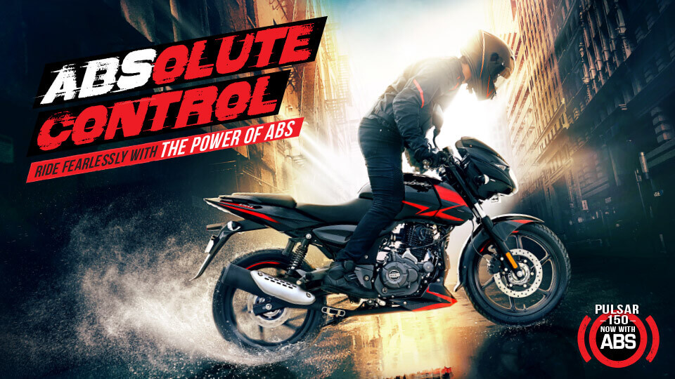 A biker doing a burnout on black and red color Bajaj Pulsar 150 Twin Disk Motorcycle with ABS wearing black leather jacket and helmet